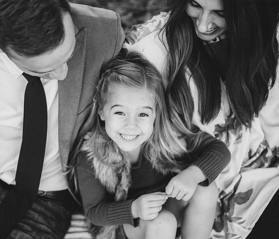 Cute child sitting with parents
